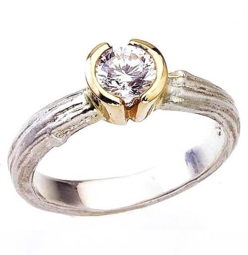 Partial bezel ring setting