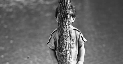 Hiding behind a tree with groovy bark