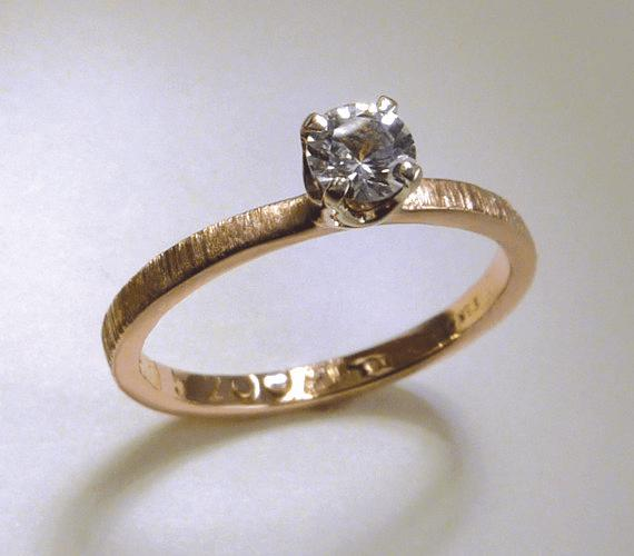 Solitaire diamond ring with textured band